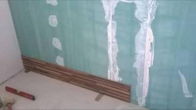Плюсы и минусы отделки стен ламинатом